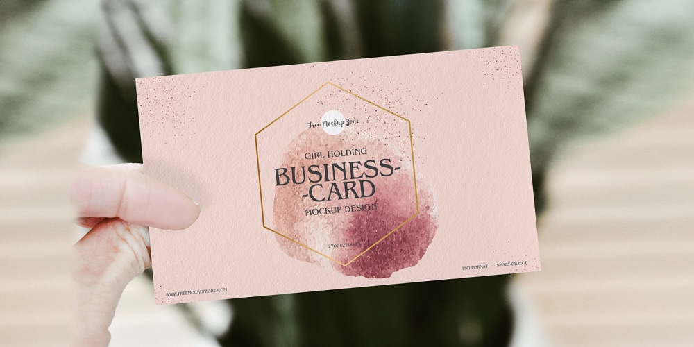 Free-Girl-Holding-Business-Card-Mockup-PSD